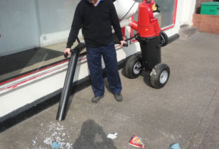 Litter collection vac attached to a trolley mounted bin